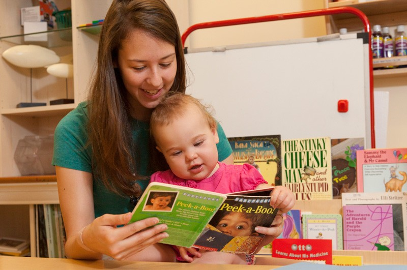 A mother and child enjoy reading together at the University of Delaware.
